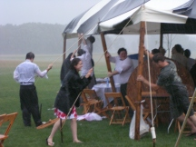 Our wedding party keeping the tent from blowing away.